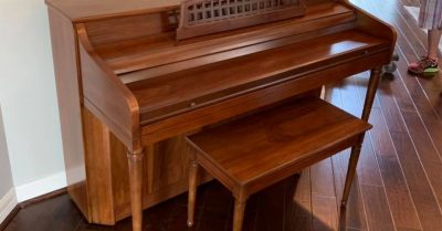 Beautiful wooden piano after Professional Piano Repairs.